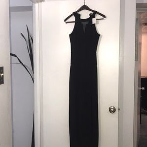 New, Never worn Long Dress with leg slits.